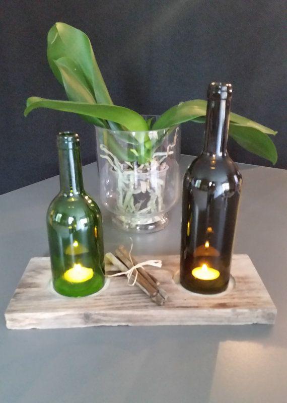 bougie dans une bouteille en verre recyclée